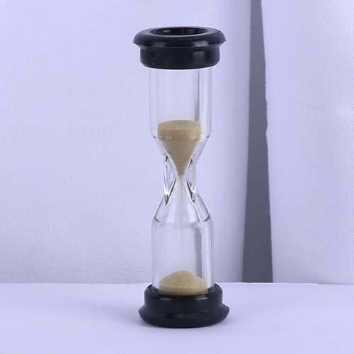 Black cap with golden sand board game sand timer